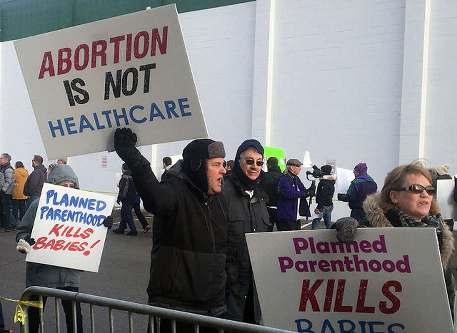 Jeff Baenen | AP Abortion opponents rally Saturday outside Planned Parenthood in St. Paul, Minnesota. Rallies aimed at urging Congress and President Donald Trump to end federal funding for Planned Parenthood were scheduled across the country.