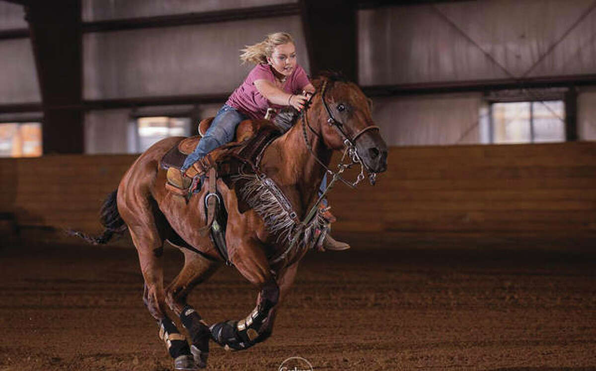 Reghan Bollinger, pictured at the age of 12, barrel racing on her quarter horse, Redneck.