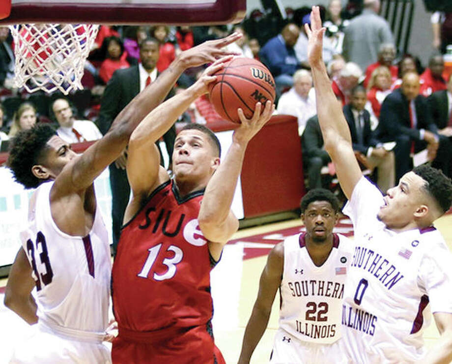 SIUE's Christian Ellis (13) goes up for a shot while being guarded by SIU Carbondale's Kavion Pippen (33), Armon Fletcher (22) and Jonathan Wiley Wednesday night at the SIU Arena. Ellis scored 16 points. SIUC's Fletcher is a junior from Edwardsville and Pippen is a nephew of former NBA great Scottie Pippen. Photo: SIUE Athletics