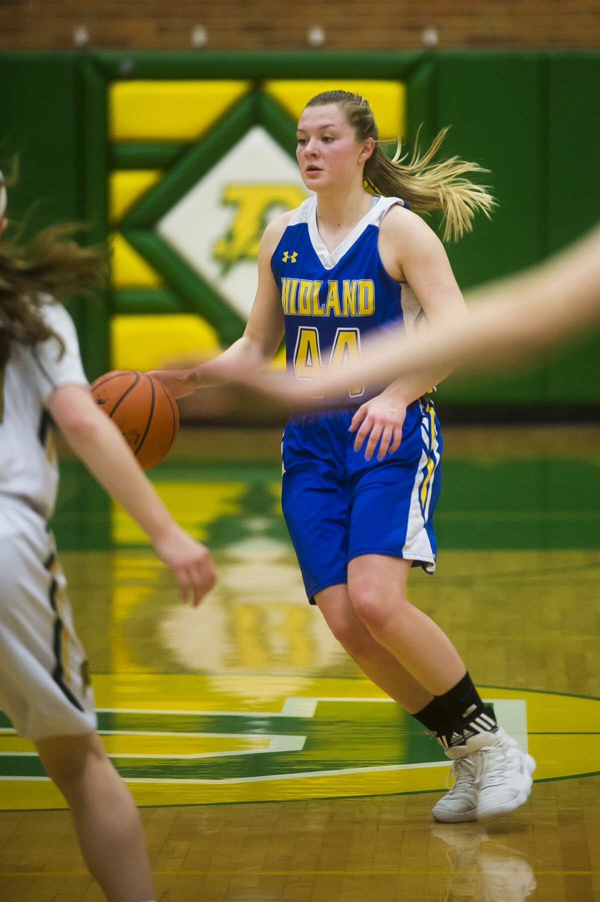 Midland senior Maddie Barrie dribbles down the court during the Chemics' game against Dow on Friday, Feb. 9, 2018 at H. H. Dow High School. (Katy Kildee/kkildee@mdn.net)