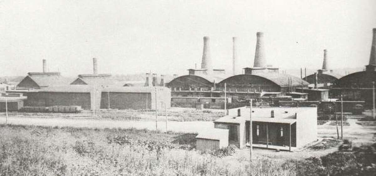 An indication that the move from a small factory at Tenth and Bell streets was the wise move for Illinois Glass is visible in this photograph taken early in this century. The many bottle-shaped smokestacks for the huge furnaces indicate that business flourished and expansion was a necessity.
