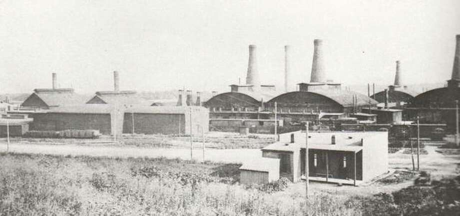 An indication that the move from a small factory at Tenth and Bell streets was the wise move for Illinois Glass is visible in this photograph taken early in this century. The many bottle-shaped smokestacks for the huge furnaces indicate that business flourished and expansion was a necessity. Photo: File Photo