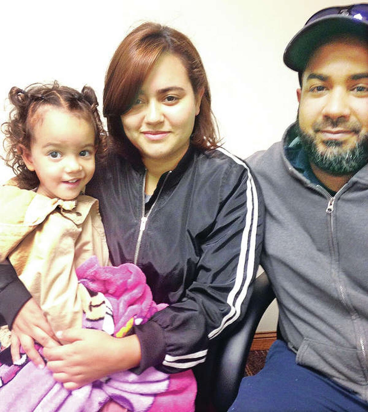 Victoria Molina, 2, and her mother Kellary Santos, 21, evacuated from Puerto Rico after Hurricane Maria and are starting a new life in Alton. They are living with Santos' father, Kelin Santos, 41, at Alton Acres public housing complex, where eight other Puerto Rican evacuees also resettled.
