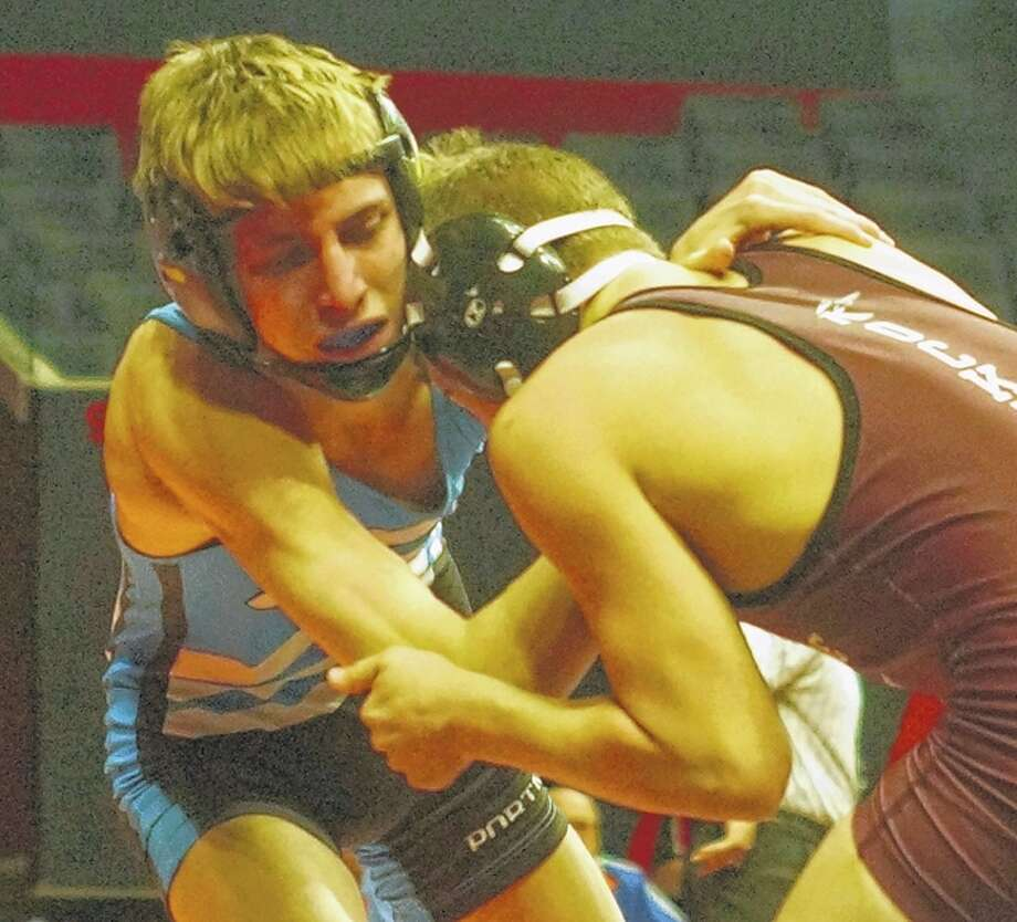 PORTA/A-C's Joe Burris (left) competes at the IHSA State Wrestling Tournament in Champaign Friday.