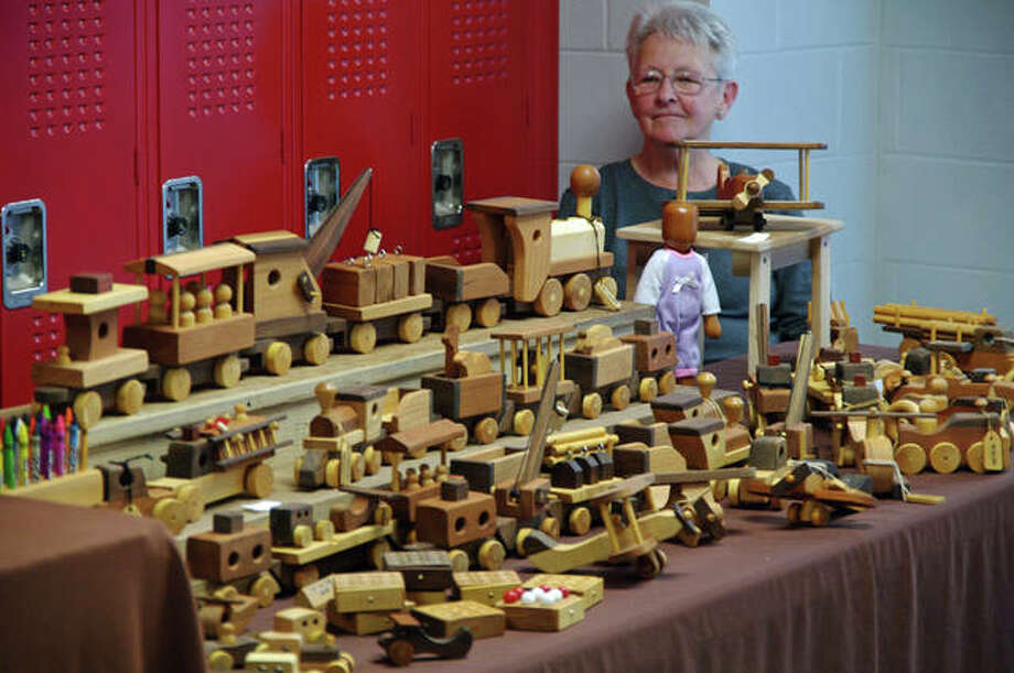 Blenda Newbury and the hand-crafted wooden toys she was selling at the Olde Alton Arts & Crafts Fair. Photo: David Blanchette | For The Telegraph