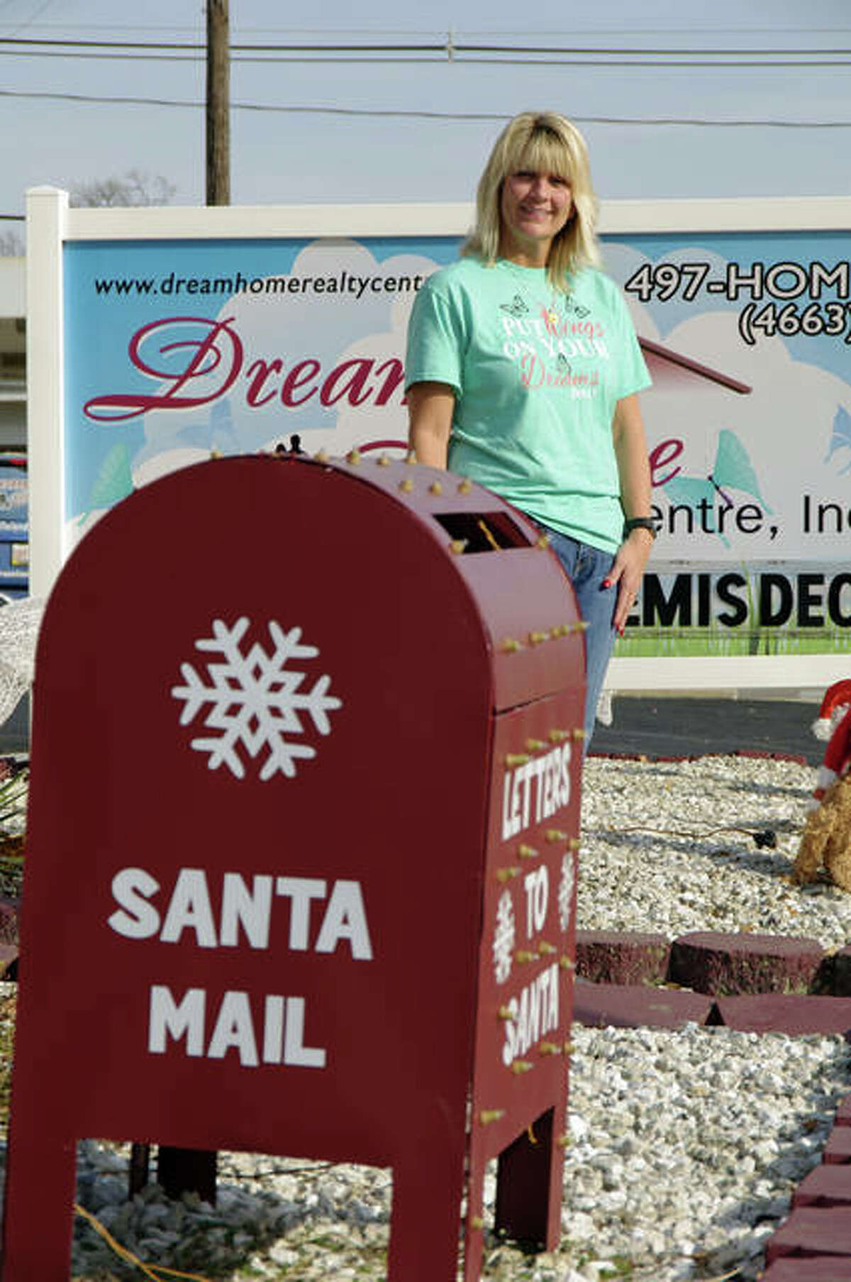 Fill Santa's Semis event organizer Sherry Gilleland at Dream Home Charities headquarters in Wood River.