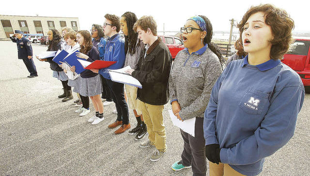 Members of the choir from nearby Marquette Catholic High School perform at the Illinois Centennial Celebration kick off Monday.