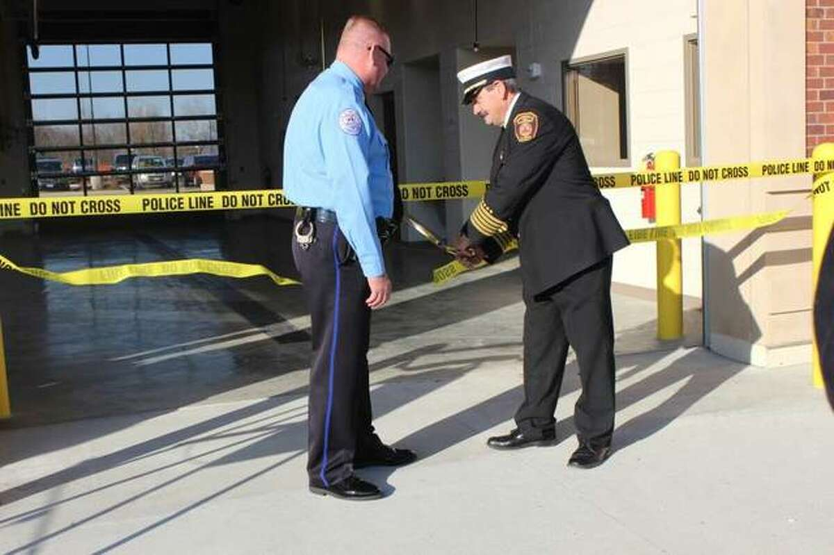 Edwardsville Police Chief Jay Keeven, left, and Edwardsville Fire Chief Rick Welle cut the ribbon to unveil the city's new public safety facility Saturday morning.