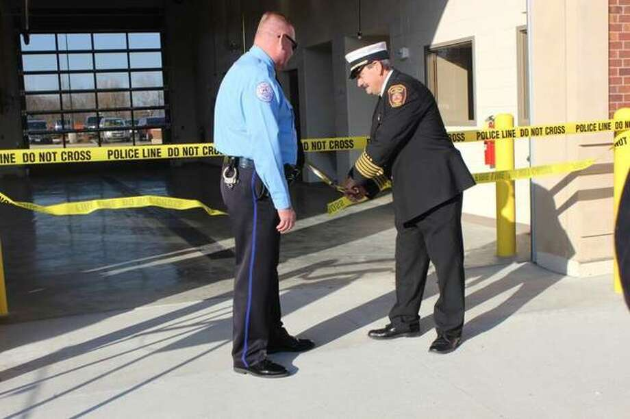 Edwardsville Police Chief Jay Keeven, left, and Edwardsville Fire Chief Rick Welle cut the ribbon to unveil the city's new public safety facility Saturday morning. Photo: Cody King | For The Telegraph
