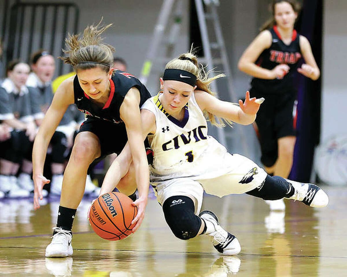 Civic Memorial's Tori Standefer (1) and Triad's Jordan Wilson (24) battle for a loose ball during Monday's Mississippi Valley Conference game in Bethalto.