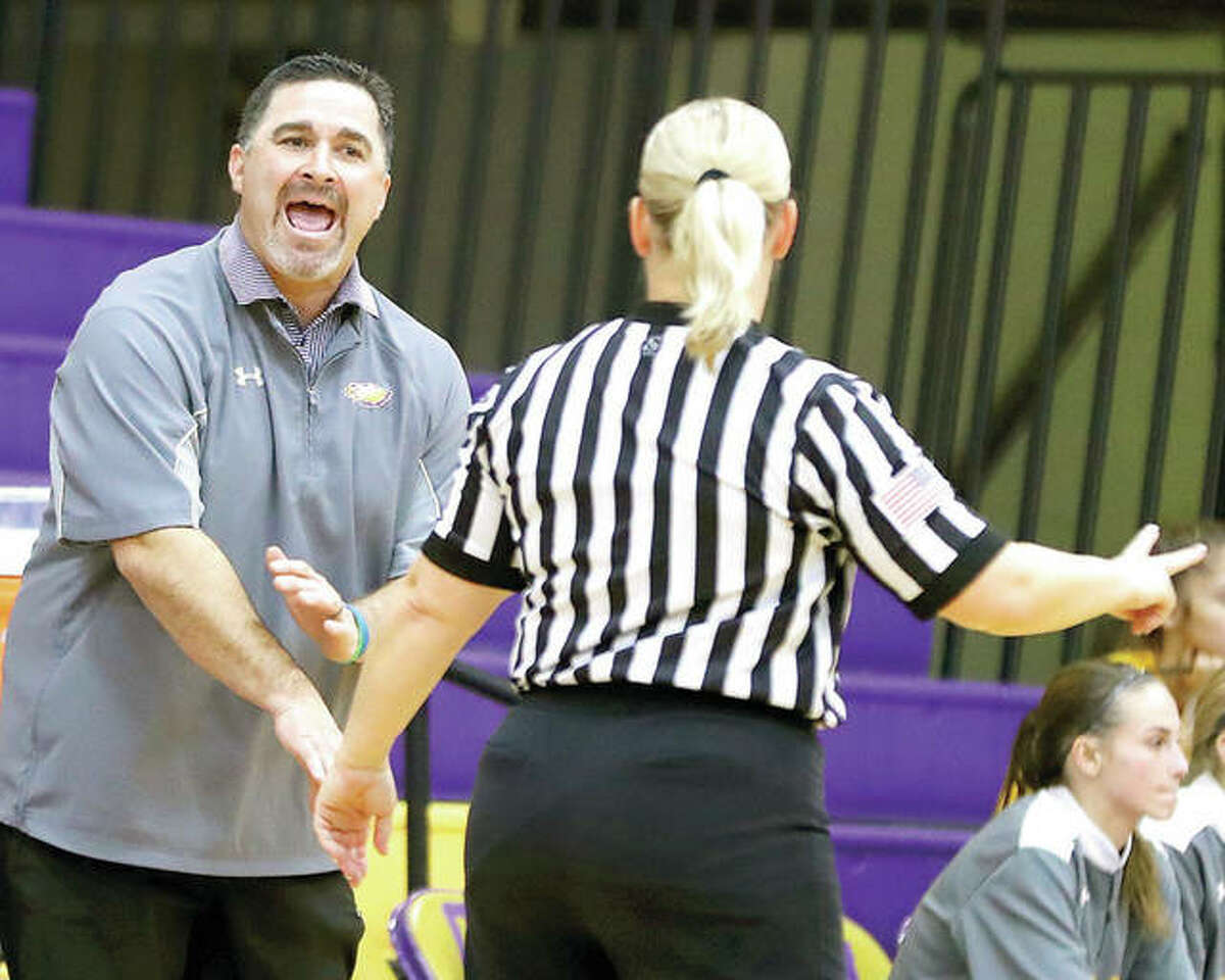 Civic Memorial coach Jonathan Denney speaks with an official during Monday's game against Triad in Bethalto.