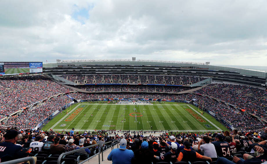 Kiichiro Sato | AP Fans watch an NFL football game between the Chicago Bears and the Detroit Lions at Soldier Field in Chicago. The Chicago Bears and the NFL Players Association are at odds over a worker compensation benefit bill in the Legislature. The bill would decide whether injured pro football players be allowed to earn worker compensation benefits until they are 67 years old, like other workers, even if their athletic careers normally would have ended more than 30 years earlier.