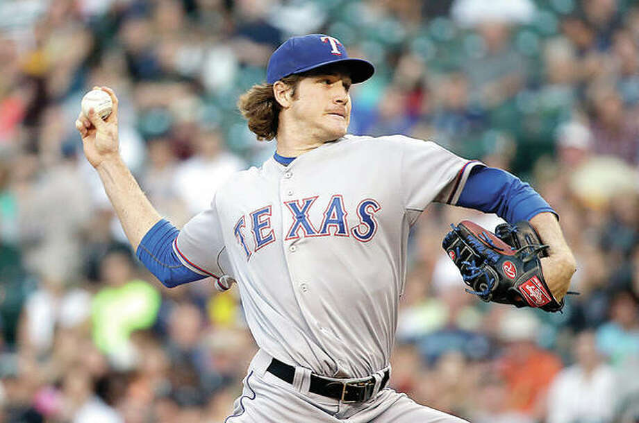 In this 2014, file photo, Miles Mikolas pitches for the Texas Rangers against the Seattle Mariners. Mikolas, 29, is returning from Japan, agreeing to a $15.5 million, two-year contract with the Cardinals. Photo: AP File