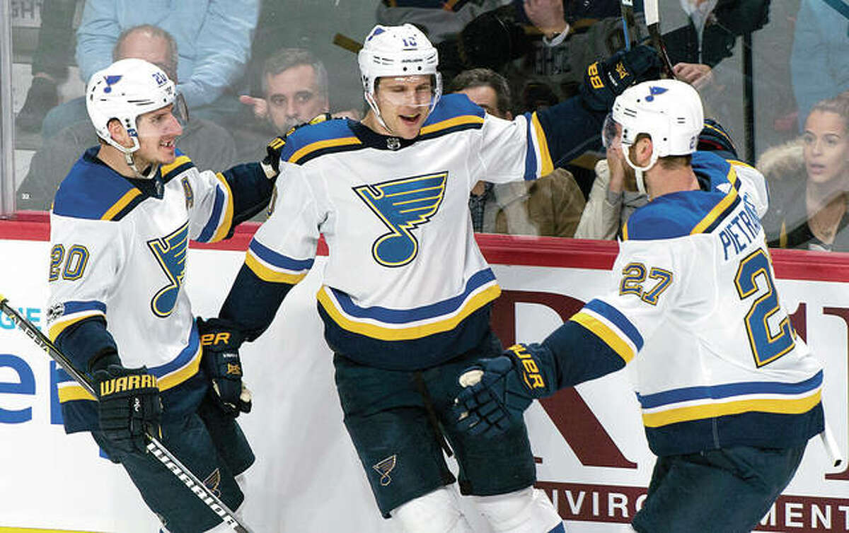 The Blues' Brayden Schenn, center, celebrates his second goal with teammates Alexander Steen, left, and Alex Pietrangelo in the second period of Tuesday's game against the Canadiens in Montreal.