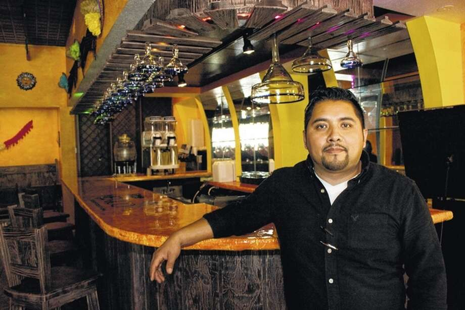 Hector Alvarado stands next to the bar at Little Mexico. Alvarado, who runs the business with help from his son, Ivan, hopes to draw customers with fresh cuisine and handcrafted cocktails. Photo: Alex Heeb | Civitas Media