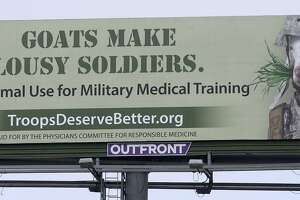 A billboard at Loop 410 and Perrin Beitel denounces the use of goats in combat medic training at Joint Base San Antonio-Fort Sam Houston. The billboard, paid for by the Physicians Committee for Responsible Medicine, urges an end to the use of animals in military medical training.