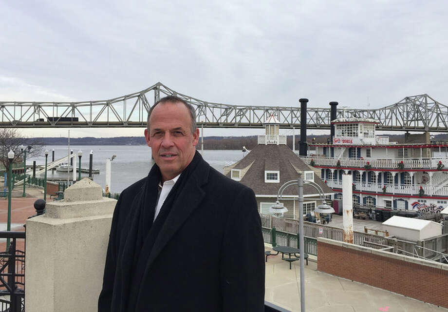 Sara Burnett | AP Mayor Jim Ardis poses for a photo in Peoria. Caterpillar's decision to move 300 top headquarters jobs to the Chicago area made Peoria the latest city with a vacuum to fill. Many midsize communities are looking to redefine themselves as more companies trade longtime hometowns for major cities with easier access to global markets and the lifestyle that talented young workers want, with nightlife and public transit.