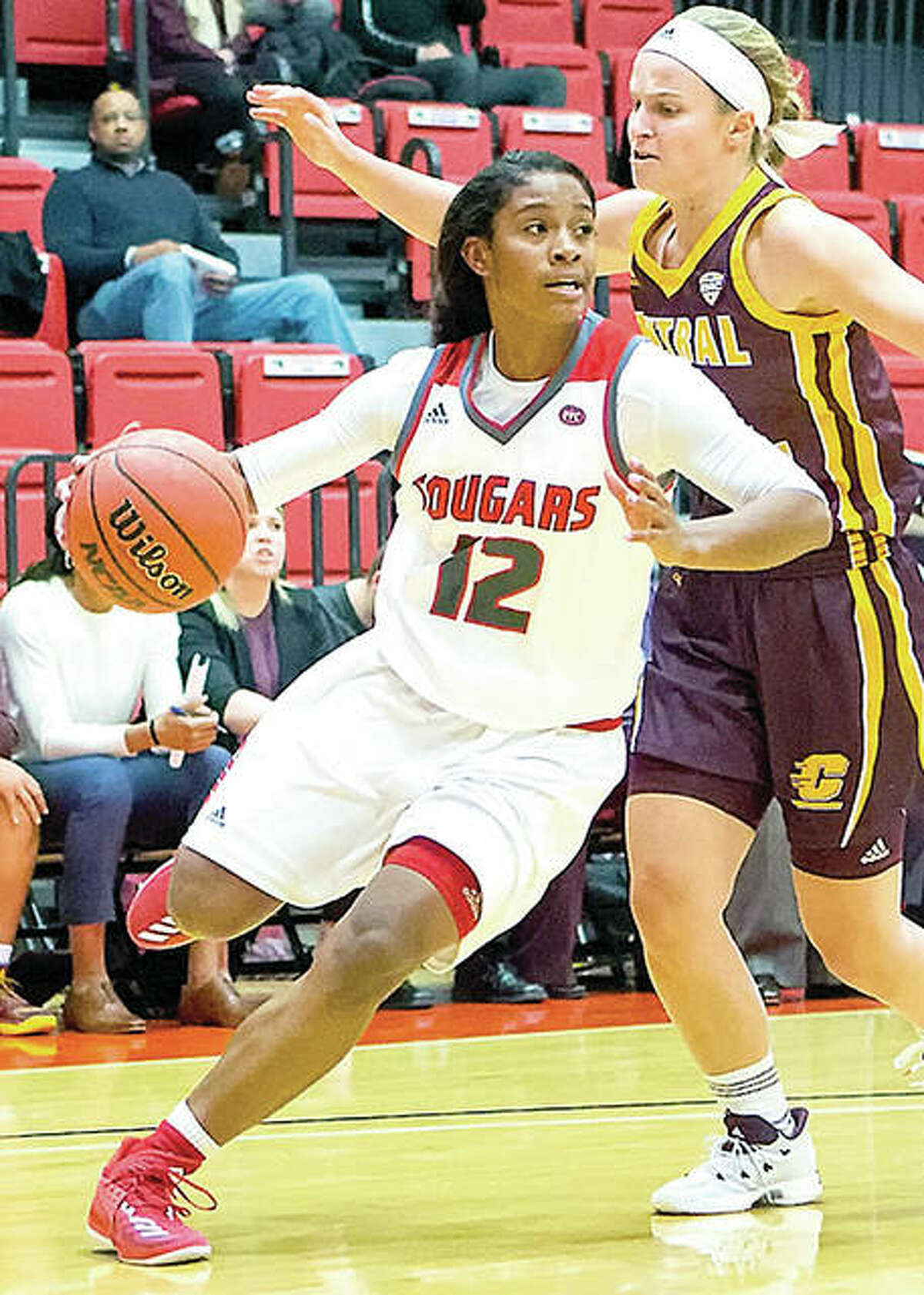 SIUE's Lauren White (12) drives against Central Michigan Thursday night at the Vadalabene Center.