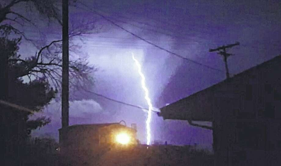 Lightning strikes during a thunderstorm Friday morning near Winchester. Photo: Elizabeth King | Reader Photo