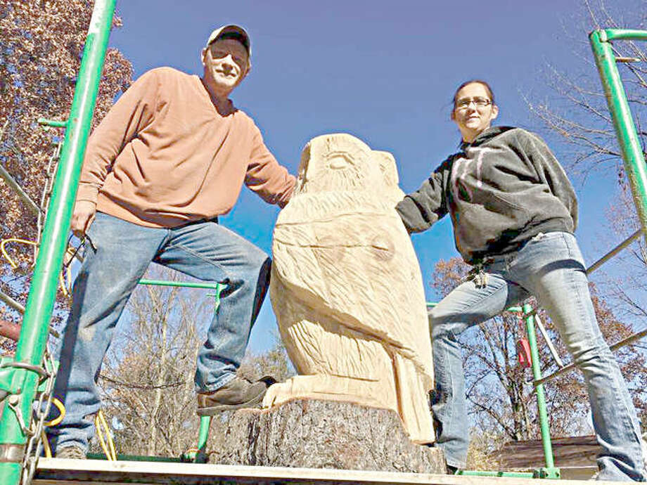 Brian Willis and Jessica Kuehnel of Chainsaw Sculptures in Granite City work on their project on Franklin Avenue. Photo: Steve Horrell | For The Telegraph