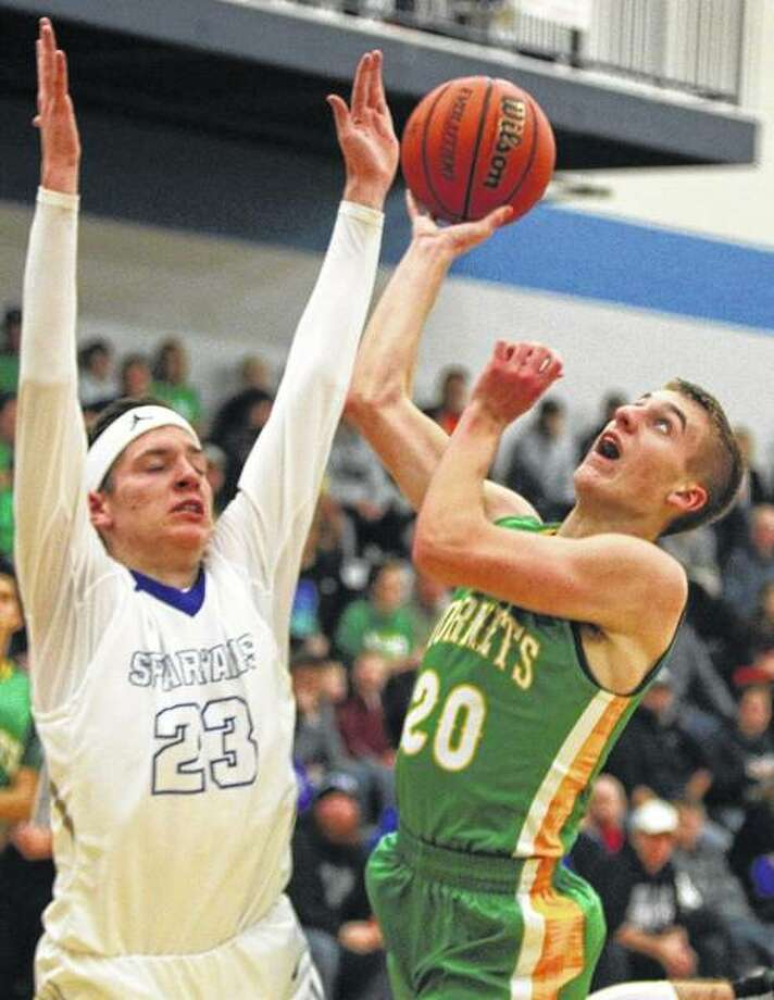 Brown County's Nathan Hendricker (right) puts up a shot over North Greene's Jonah Hopper during Friday night's championship game of the North Greene Tournament in White Hall. Brown County won in overtime. Photo: Dennis Mathes / For The Telegraph