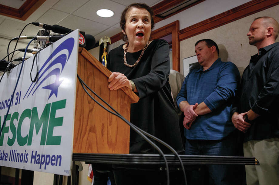 Justin L. Fowler | State Journal-Register (AP) Roberta Lynch, executive director of American Federation of State, County and Municipal Employees Council 31, announces that Illinois AFSCME members voted to authorize the union's executive committee to call a walkout if talks with the state don't progress. Gov. Bruce Rauner says AFSCME's actions are unfairly hurting taxpayers and Illinois' workforce is the highest paid in America.
