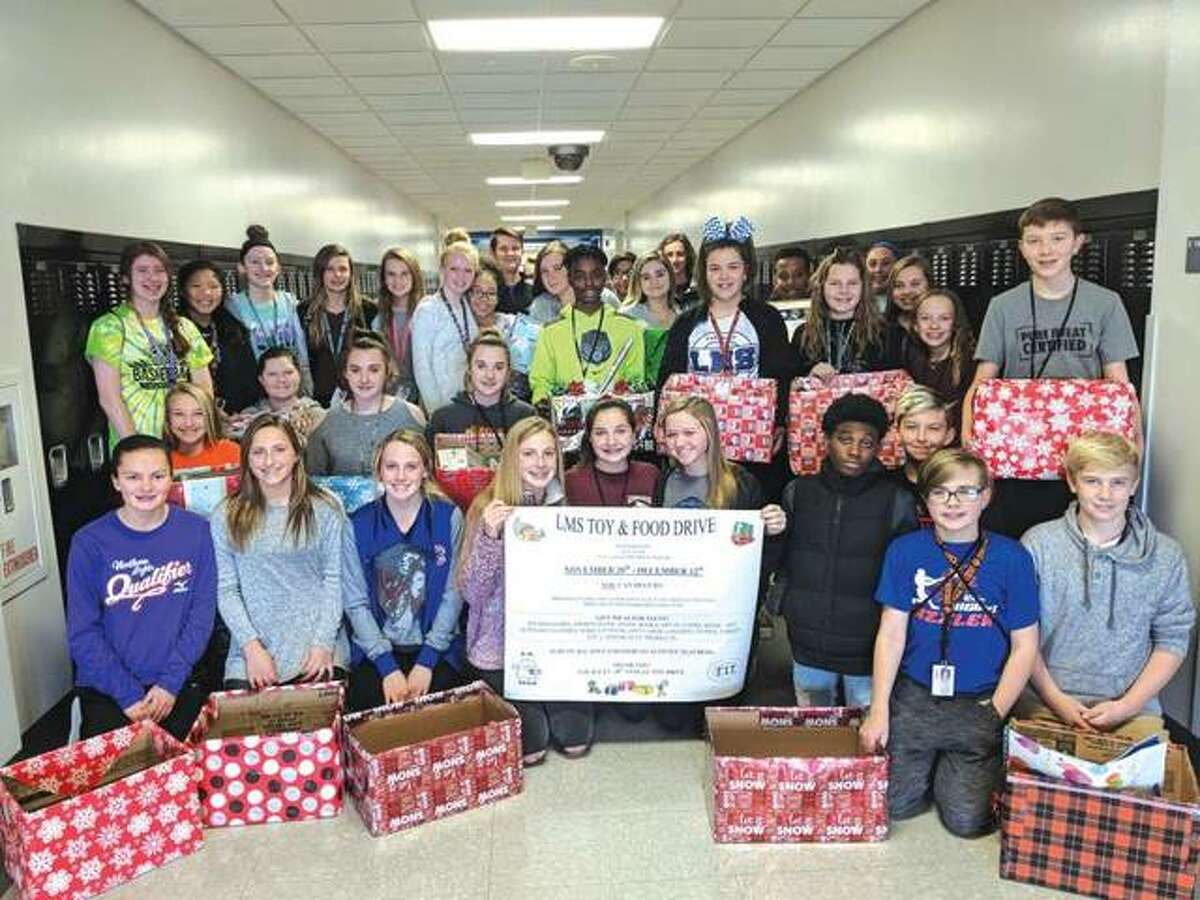 Members of Liberty Middle School's F.I.T. and G.O. clubs are prepared for their 18th Annual Toy and Food Drive.
