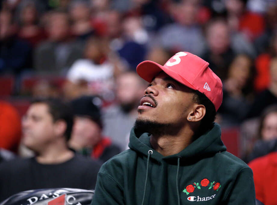 Charles Rex Arbogast | AP Chance the Rapper takes watches an NBA basketball game between the Chicago Bulls and the Phoenix Suns in Chicago. Gov. Bruce Rauner and the rapper plan to meet this week to discuss funding education.