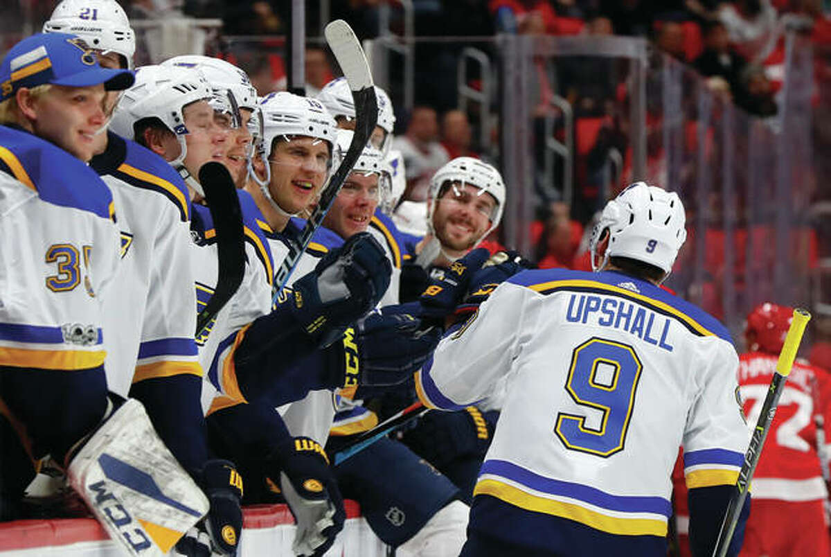 The Blues' Scottie Upshall (9) greets teammates on the bench after goal against the Red Wings on Saturday afternoon in Detroit.