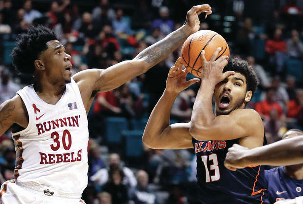 Illinois' Mark Smith (right) grabs a rebound away from UNLV's Jovan Mooring during the second half Saturday night in Las Vegas. Smith, a freshman from Edwardsville, had a team-high 17 points in the Illini loss.