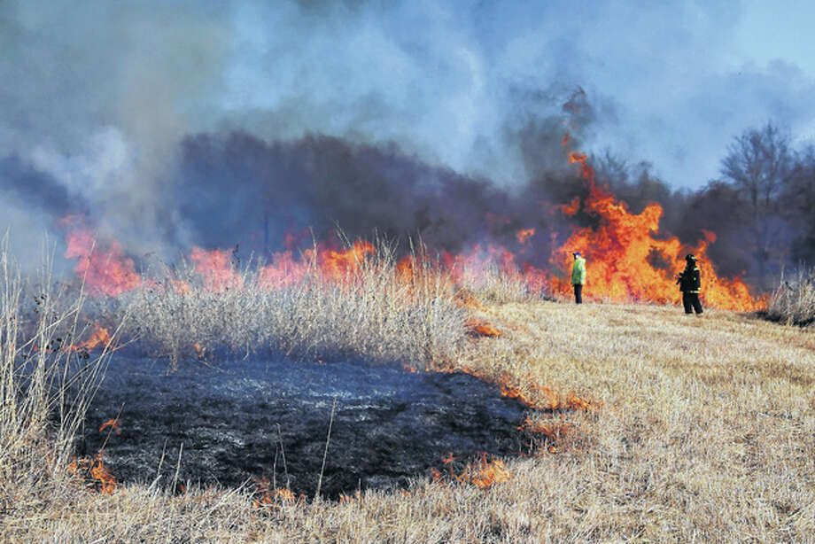 Members of the Virginia Fire Department burn off a portion of Rexroat Prairie on Monday. Controlled burning during cooler months can reduce the likelihood of dangerous fires during the spring and summer. Photo: Robert Daniel | For The Journal-Courier