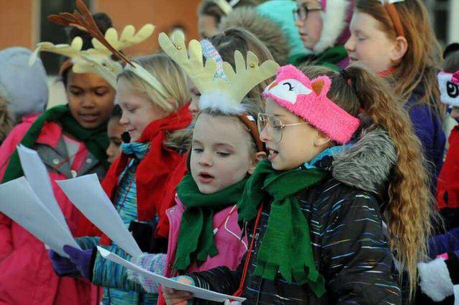 Children sing Christmas carols during the Christmas Walk.