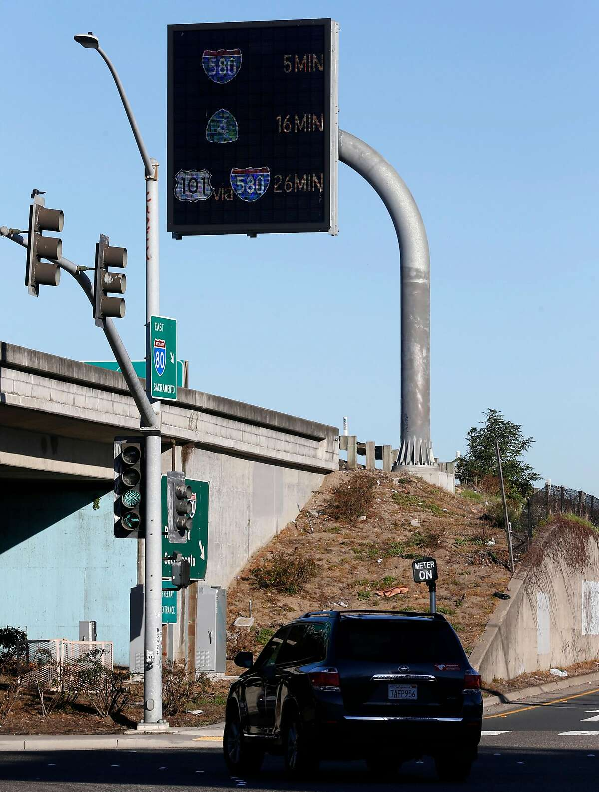 A large electronic message board displays travel times to freeway interchanges along eastbound Interstate 80 at Powell Street in Emeryville, Calif. on Wednesday, Feb. 7, 2018. The displays were installed as part of the I-80 Smart Corridor traffic management project installed by Caltrans.