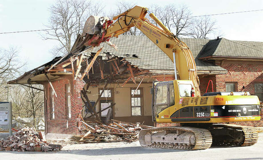 John Badman|The Telegraph It didn't take long for the trackhoe demolishing the old Alton Amtrak station on College Avenue to open up the western wall of the decades old train station.