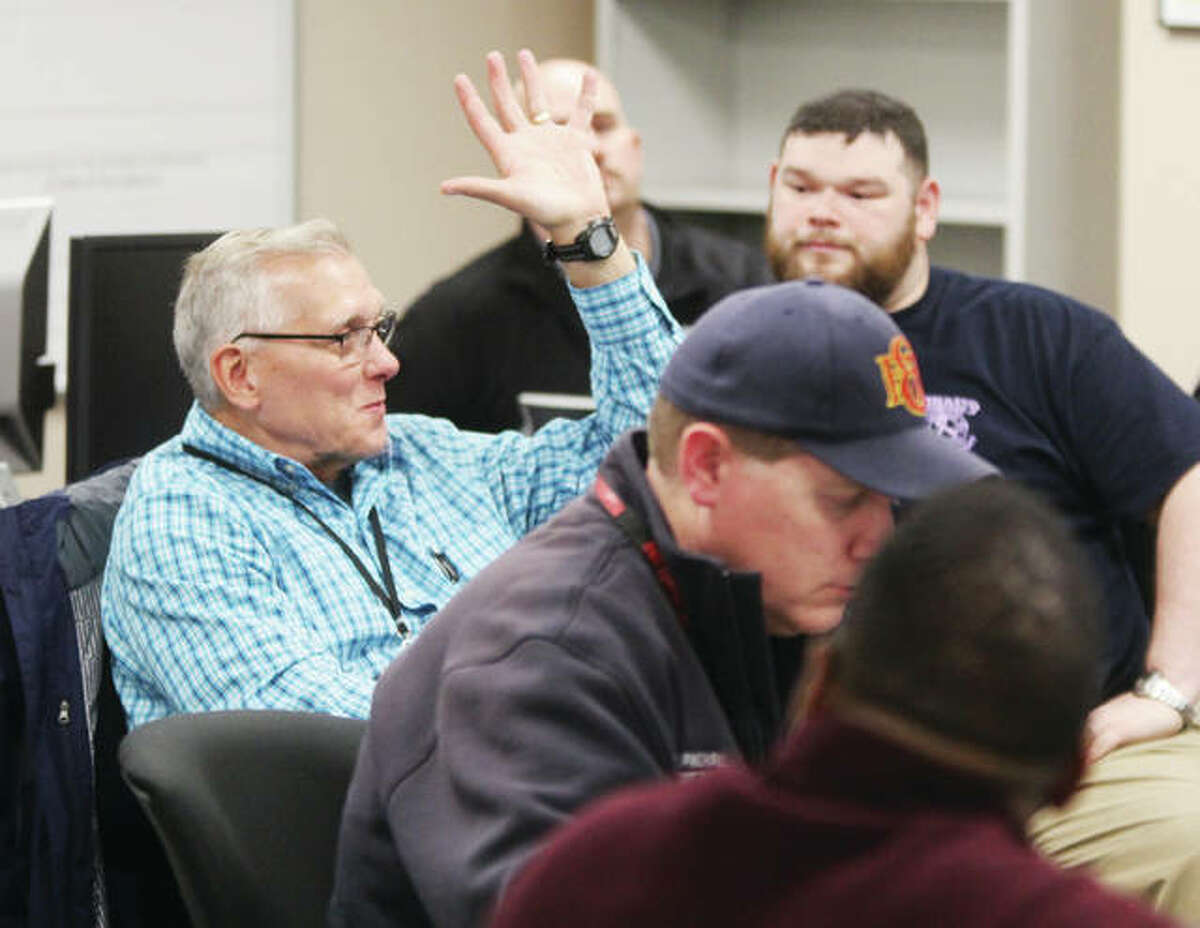 Steven Brendel, stormwater coordinator for Madison County Community Development, makes a point during a tabletop exercise dealing with a flooding emergency held at the Madison County Emergency Management Agency office Tuesday morning. About 20 people participated in the exercise, the first step toward a full-scale emergency drill planned for late 2018.