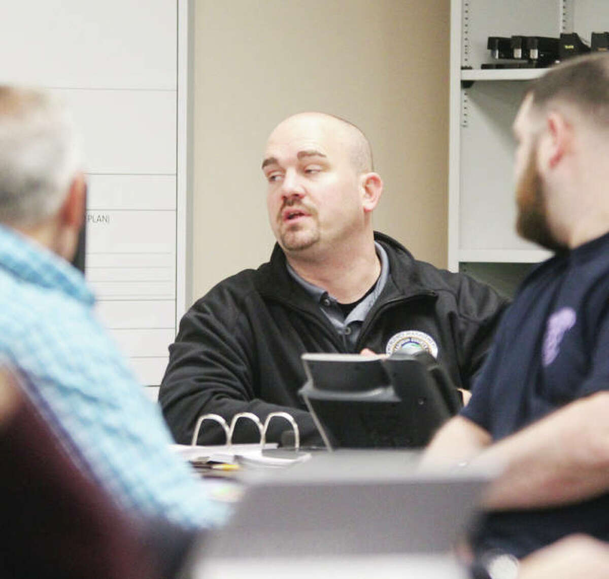 Tony Falconio, logistics coordinator for Madison County Emergency Management Agency, talks during a tabletop exercise dealing with a flooding emergency held at the Madison County Emergency Management Agency office Tuesday morning.