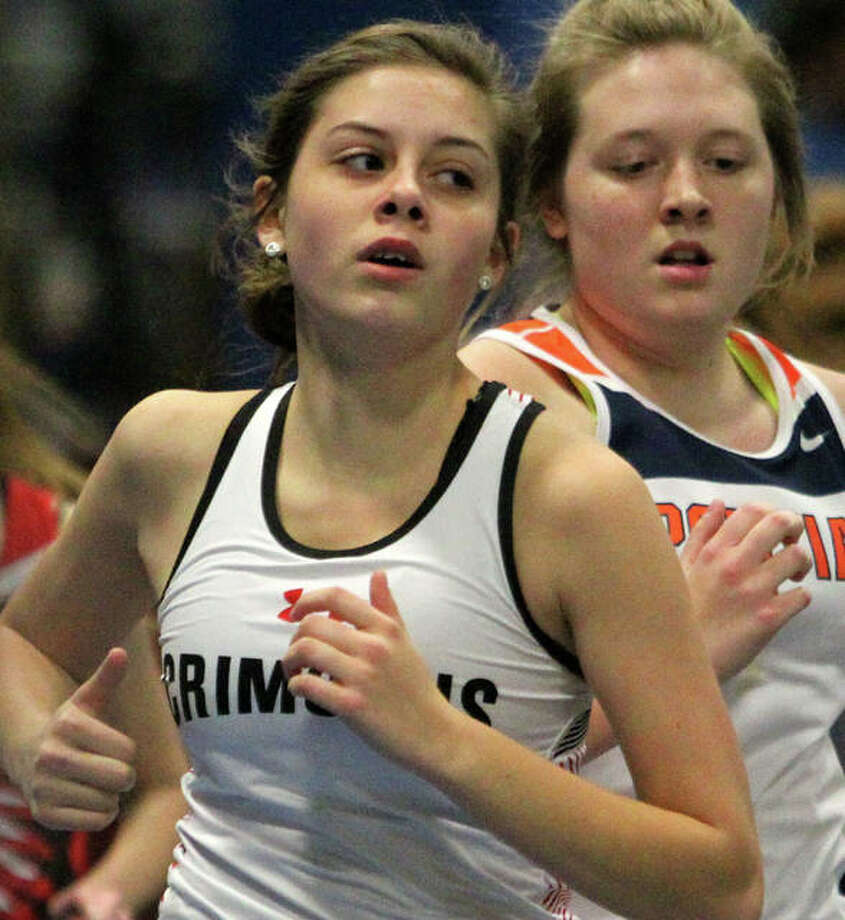 Jacksonville's Alandra Antle (left) competes in the 800-meter run during an indoor track meet at Illinois College Friday night. Photo: Dennis Mathes | Journal-Courier