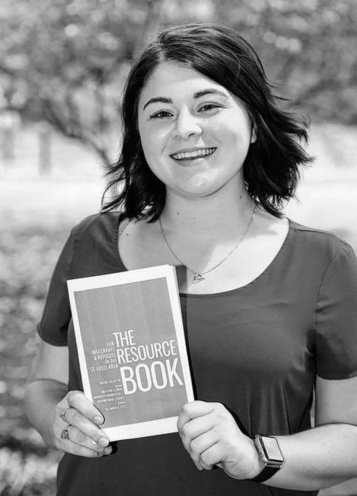 Rachel Thurston, the first graduate of SIUE's undergraduate international studies program, holds the resource book she created for area immigrants and refugees. She will earn her bachelor's on Saturday, Dec. 16 during SIUE's Fall 2017 commencement ceremony.