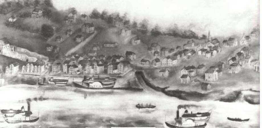 This primitive scene of Alton in 1836 was painted by W.H. Temple and for many years was the property of Mrs. George A. Savage. At the extreme left is a distillery. Next is the building where Lovejoy was slain. The steepled building on the extreme right is the First Baptist Church. The boat landing and Piasa Creek are clearly seen in the center of the painting. The penitentiary is shown and the artist has attempted to create the effect of the steep hills of Alton with the roads leading down to the Mississippi. Photo: File Photo