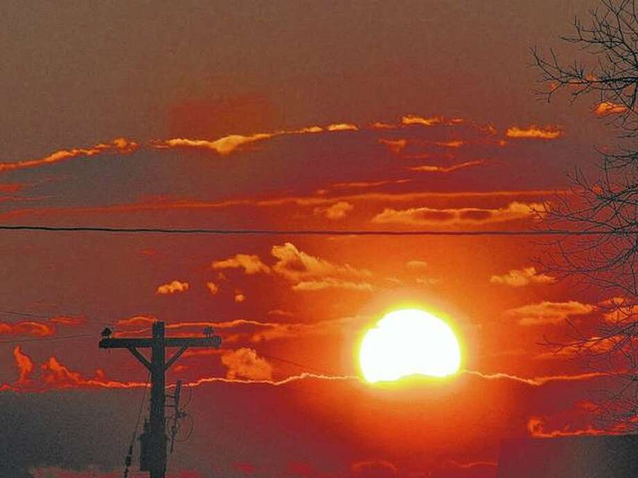 The sun sets the sky over Macoupin County aglow. Photo: Beverly Watkins | Reader Photo