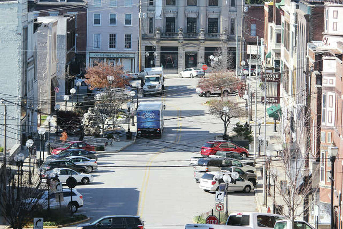 """The bustle of Downtown Alton is pictured along Third Street, which will be among the sites used for a reality television program focused on bringing small businesses to the next level. Alton is among the final top 10 contenders for the program, """"Small Business Revolution - Main Street."""""""