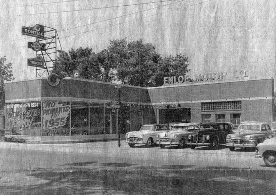 This building, once at 923 S. Main St., originally was the home of Enloe Motor Co. Over the years, the building housed a Firestone tire store, FS Tire Center, Midas Muffler and Brake Shop and finally Western FS Auto Home Supply Store. The building was demolished in 2001 to make way for a Walgreens store. This photo was taken around 1954.