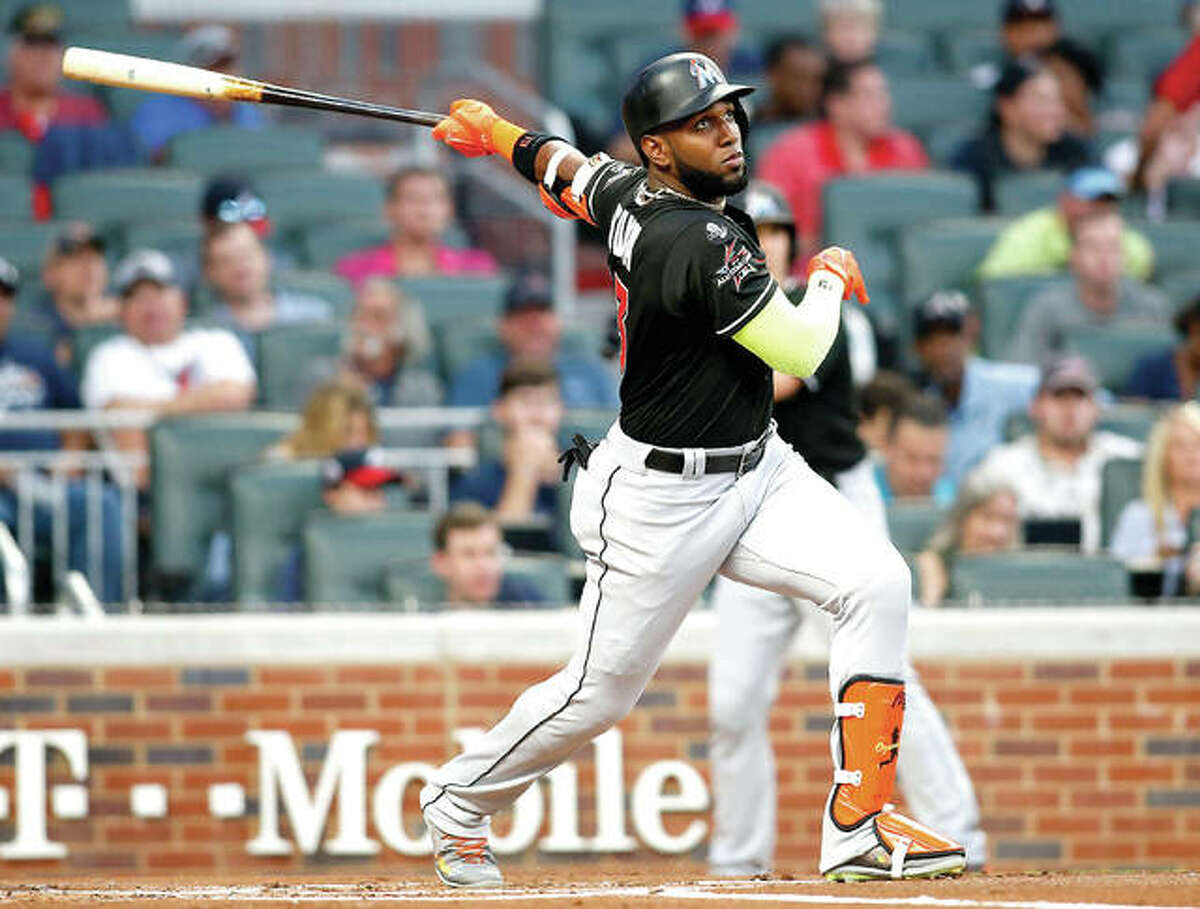 Miami has agreed to trade left fielder Marcell Ozuna to the Cardinals. He is the third All-Star jettisoned by the Marlins this month in an unrelenting payroll purge under new CEO Derek Jeter.