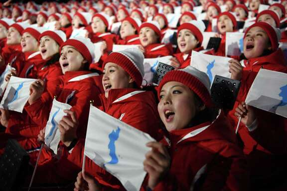 North Korean athletes sing and hold the unification flag depicting a unified Korean peninsula before the start of the opening ceremony of the 2018 Winter Olympics in Peongchang, South Korea, on Friday, Feb. 9, 2018. (James Hill/The New York Times) -- NO SALES --