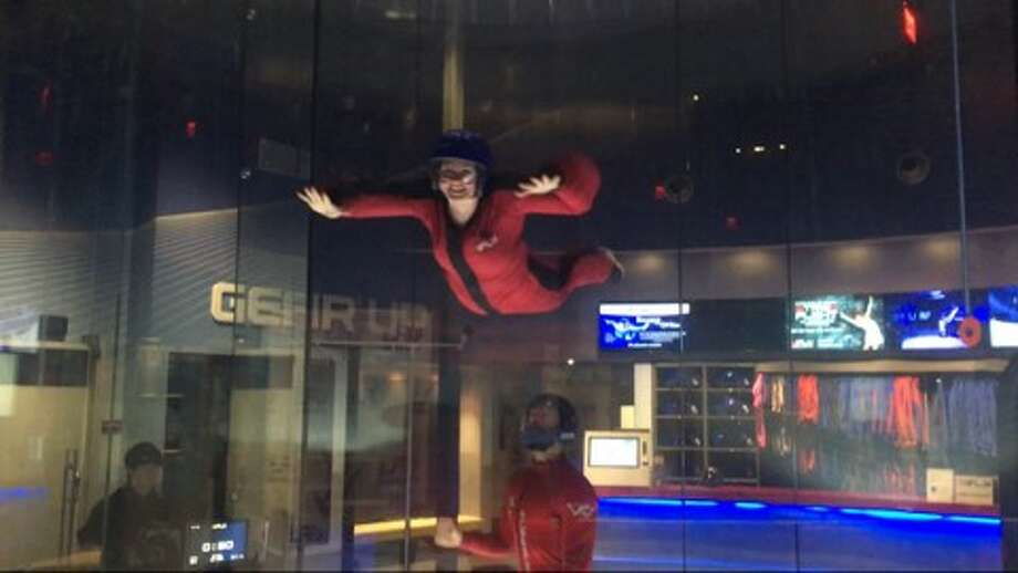 Patricia Dillon, features reporter with The Woodlands Villager, takes her first flight at iFLY Houston in The Woodlands with flight instructor and indoor skydiving competitor John Wiggins. Photo: Photo Courtesy Of Maddie Dunn