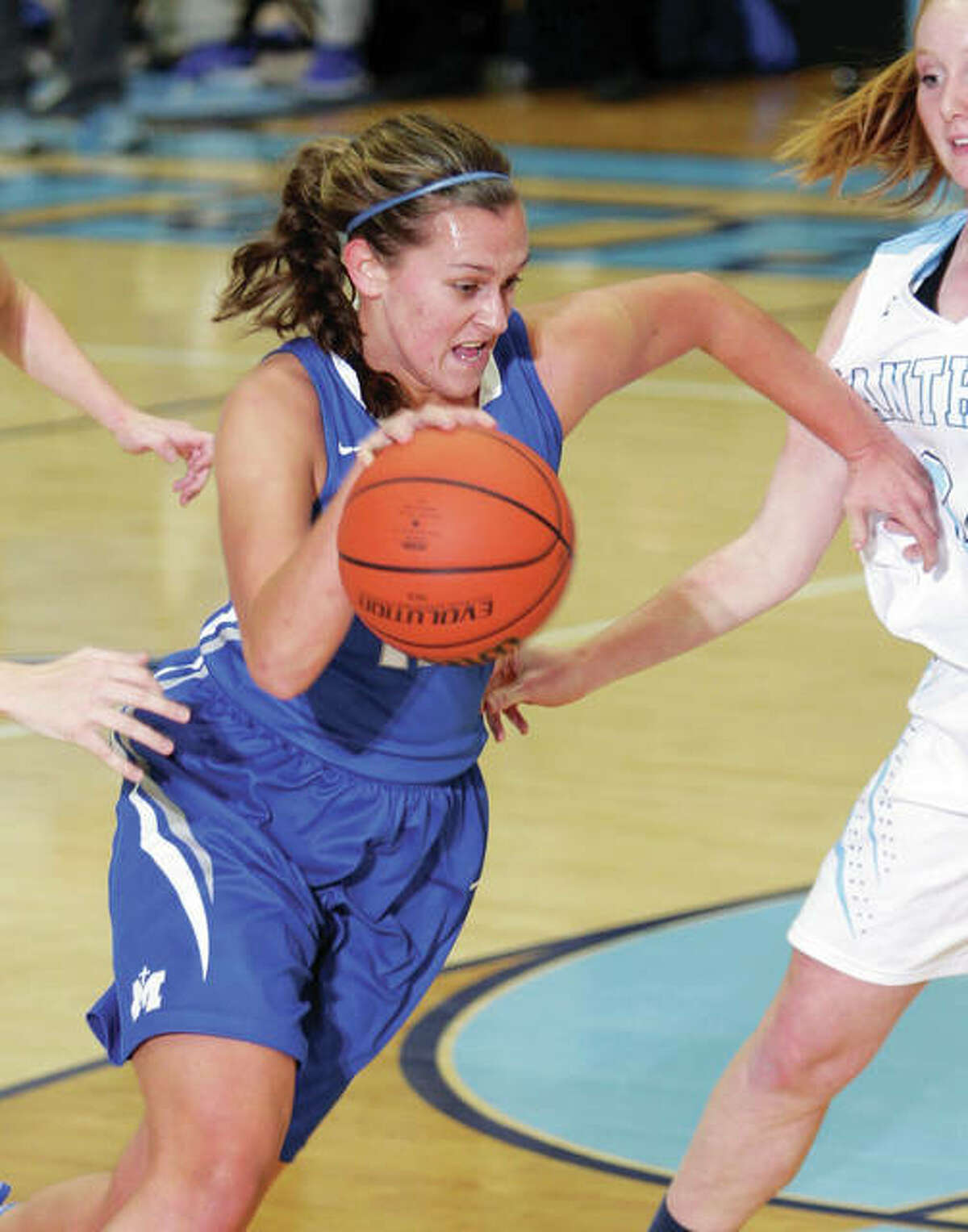 Marquette Catholic's Lauren Fischer drives to the basket during an Explorers win Dec. 6 at Havens Gym in Jerseyville. On Wednesday night, Fischer scored 26 points to lead the Explorers to a semifinal win over host Gibault at the Candy Cane Classic in Waterloo.