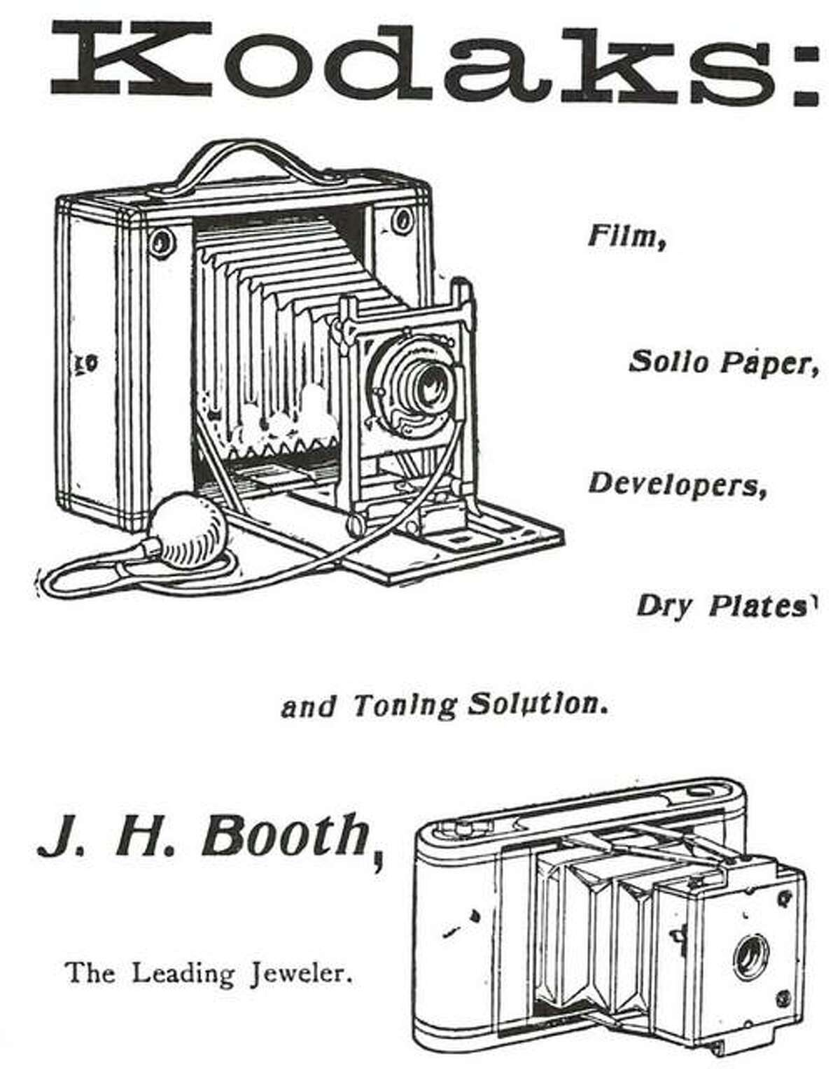 """The word KODAK did not exist until George Eastman decided it was the descriptive word he needed for his invention. It had a nice ring to it, and meant nothing in English or any other language. Since the 1880s, the word has stood for a picture-taking device of one form or another. In the past, the """"machines"""" were sold by jewelers such as Alton's J.H. Booth, """"the Leading Jeweler."""" As the ad states, developing chemicals were usually purchased from him also, or from a druggist. Many a home had a darkroom and prints were easily made on blueprint paper, which required only water to cause the image to appear once it had been exposed to light through the negative. The above illustration shows a roll film camera which used a large roll, taking 4- by 5-inch pictures. The other camera used a smaller film, and was a """"pocket camera."""""""