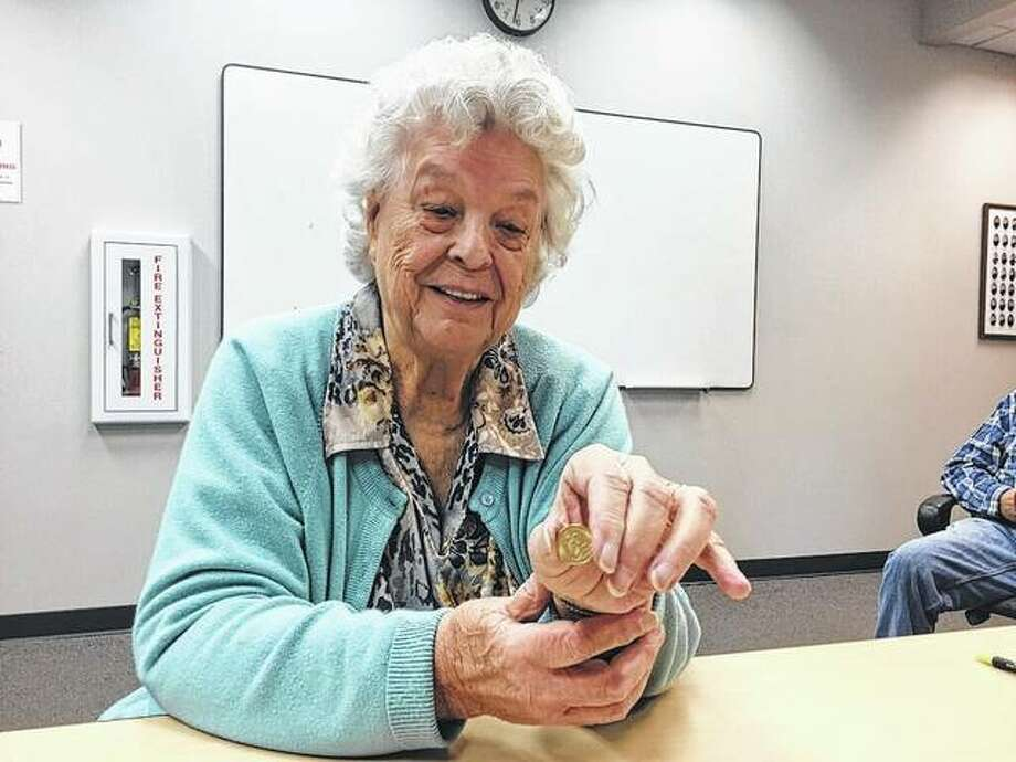Salvation Army — Alton Corps kettle counter Fran Steward shows off the second gold coin found by bell-ringers in recent days. Photo: For The Telegraph