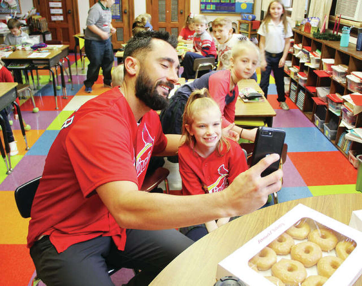 Baseball player Matt Carpenter takes a selfie with Jocelyn Thomas, the 8-year-old girl who won a contest that brought him to St. Mary's Catholic School for the morning. Carpenter spent the morning playing games with students, and getting to know them.