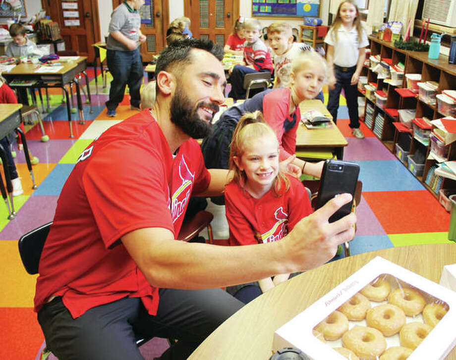 Baseball player Matt Carpenter takes a selfie with Jocelyn Thomas, the 8-year-old girl who won a contest that brought him to St. Mary's Catholic School for the morning. Carpenter spent the morning playing games with students, and getting to know them. Photo: Scott Cousins | The Telegraph